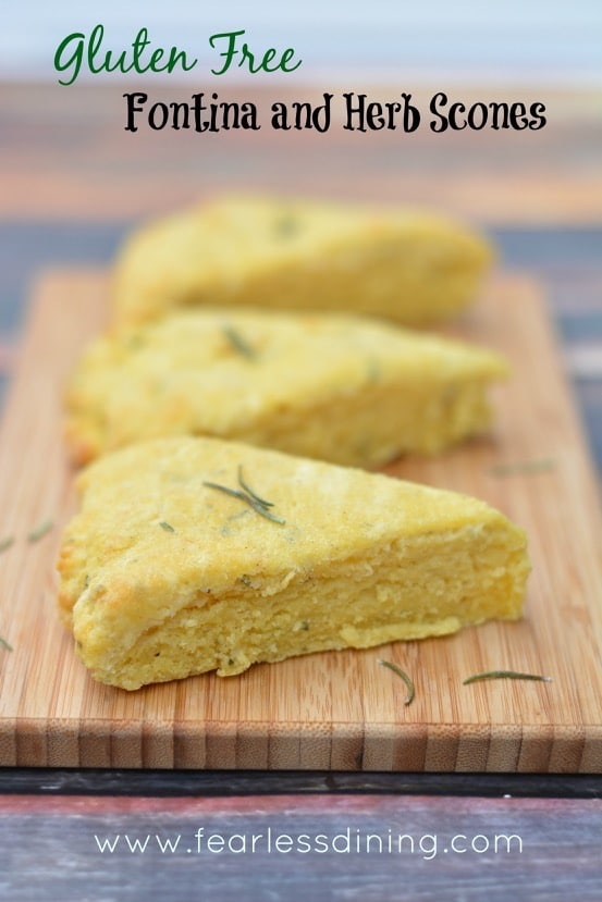 Gluten Free Fontina Herb Scones on a cutting board with rosemary ...
