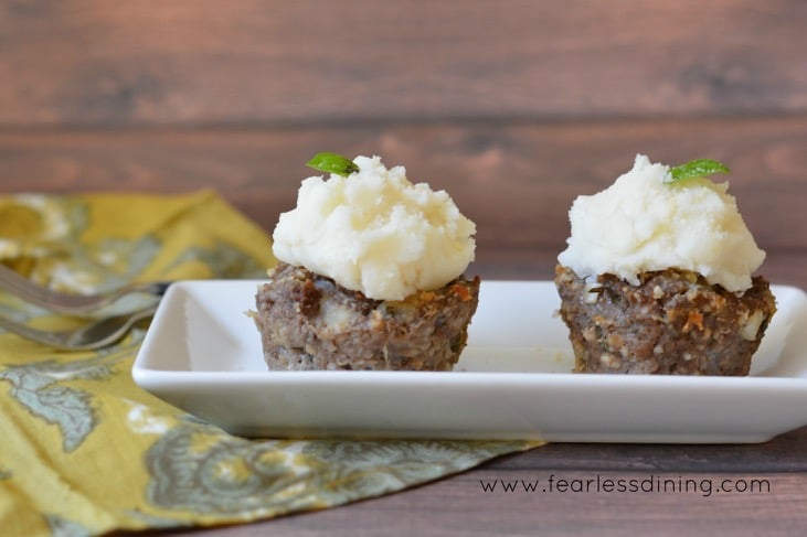 Two mini Italian gluten free meat loaves may look like cupcakes, but they are a savory and delicious dinner idea. Your kids will love these, even when they realize these meat loaves are healthy! Fun for April Fool's.