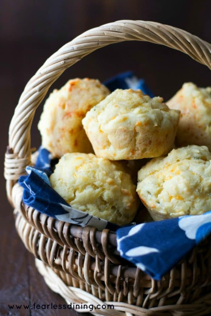 Gluten Free savoury muffins in a basket. The basket has a blue floral napkin liner