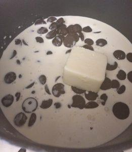 fondue cream, chocolate, and butter in a fondue cooker