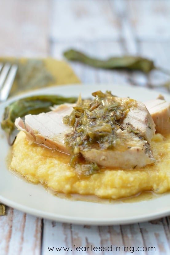 Close up of Chicken with Shishito Pepper Sauce Over Polenta