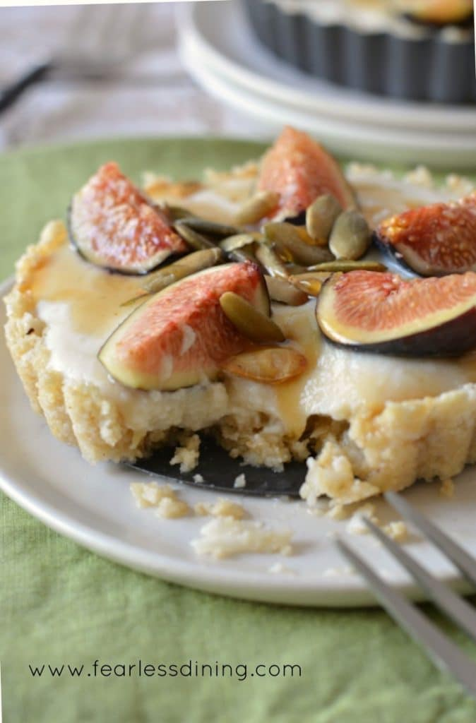 A fork cutting into a raw fig tart