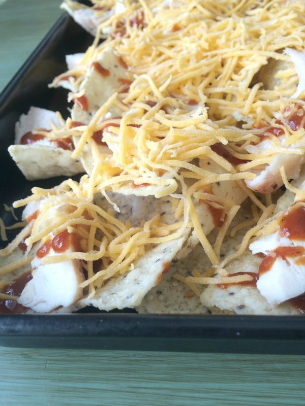 Chicken, Sauce, Cheese on top of chicken nachos