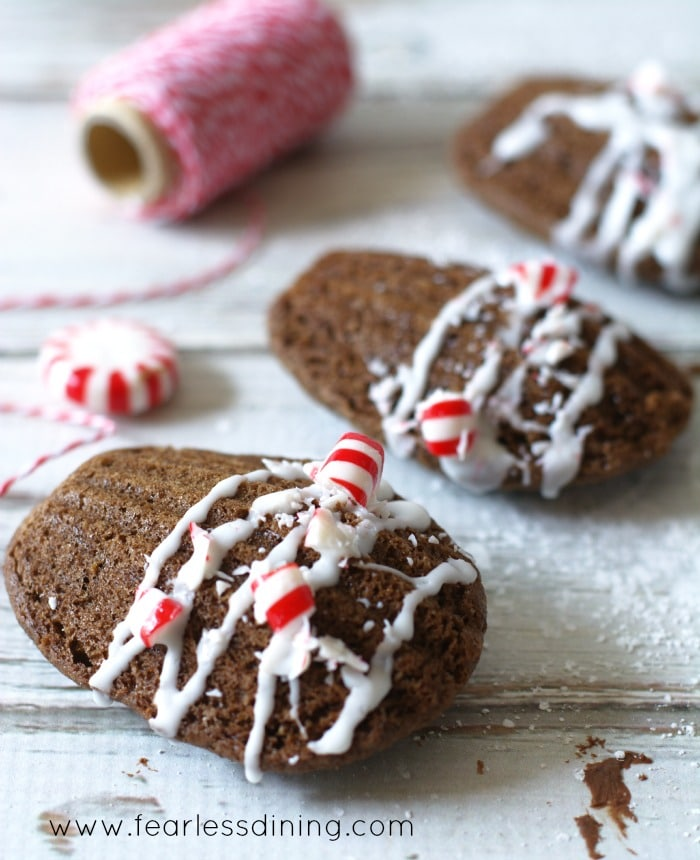 Gluten Free Peppermint Madeleines in a row with crushed peppermint candy on top