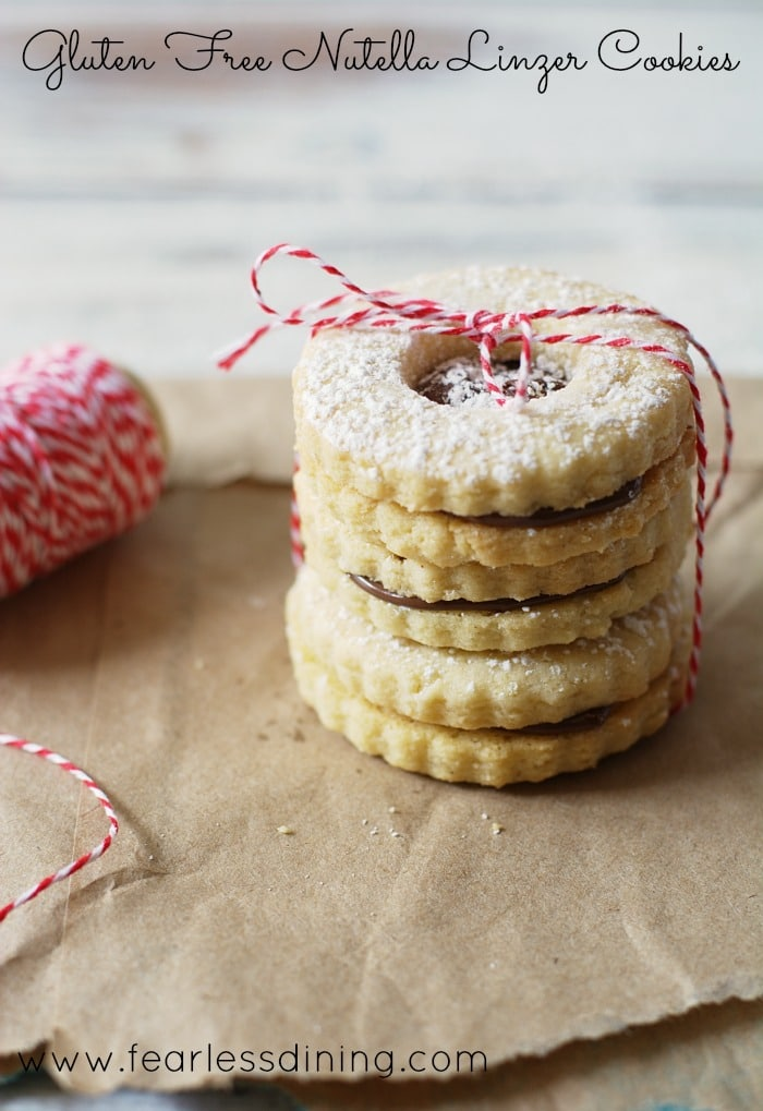 Gluten Free Nutella Linzer Cookies in a stack tied with a baker's string
