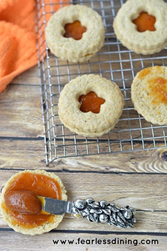 Gluten Free Pumpkin Butter Linzer Cookies getting jam spread on