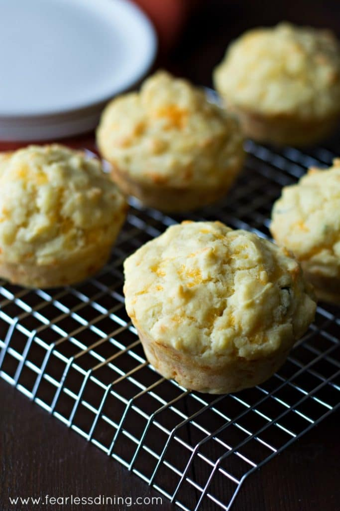 Close up picture of Gluten Free Cheddar Herb Muffins on a cooling rack