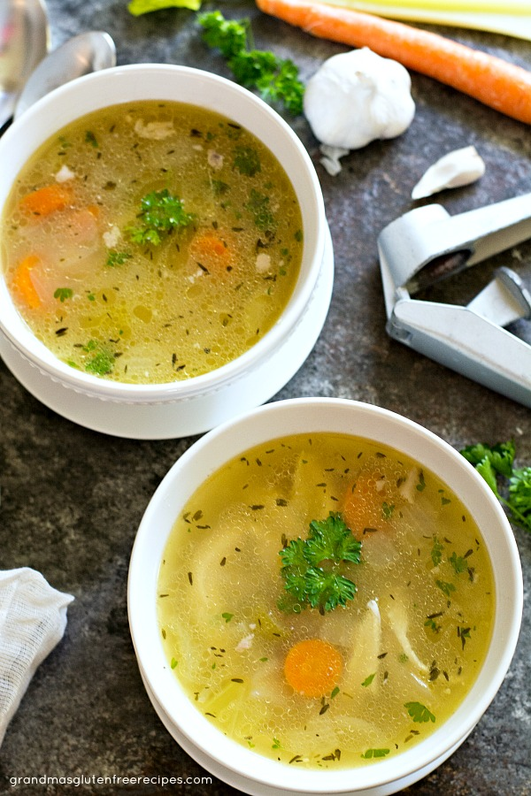 Two bowls of the he best homemade chicken soup